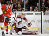 Chicago center Jonathan Toews (19) redirects a shot past Phoenix goalie Mike Smith (41) for a goal during the NHL game between the Chicago Blackhawks and the Phoenix Coyotes at the United Center in Chicago, IL. The Coyotes defeated the Blackhawks 4-3 in a shootout.