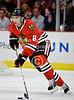 Chicago defenseman Nick Leddy (8) handles the puck during the NHL game between the Chicago Blackhawks and the Phoenix Coyotes at the United Center in Chicago, IL. The Coyotes defeated the Blackhawks 4-3 in a shootout.