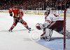 Chicago center Jonathan Toews (19) moves in on Phoenix goalie Mike Smith (41) on his shootout attempt during the NHL game between the Chicago Blackhawks and the Phoenix Coyotes at the United Center in Chicago, IL. The Coyotes defeated the Blackhawks 4-3 in a shootout.