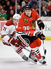 Chicago center Dave Bolland (36) evades Phoenix center Martin Hanzal (11) during the NHL game between the Chicago Blackhawks and the Phoenix Coyotes at the United Center in Chicago, IL. The Coyotes defeated the Blackhawks 4-3 in a shootout.