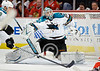 San Jose goalie Antti Niemi (31) lunges to make a save during the NHL game between the Chicago Blackhawks and the San Jose Sharks at the United Center in Chicago, IL. The Blackhawks defeated the Sharks 4-3.