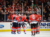 Chicago left wing Patrick Sharp (10), and defenseman Niklas Hjalmarsson (4) congratulate center Marcus Kruger (16) on his goal during the NHL game between the Chicago Blackhawks and the San Jose Sharks at the United Center in Chicago, IL. The Blackhawks defeated the Sharks 3-2 in overtime.