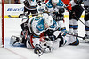 San Jose goalie Antti Niemi (31) covers the puck while left wing Brad Winchester (10) and Chicago right wing Jamal Mayers (22) topple on top of him during the NHL game between the Chicago Blackhawks and the San Jose Sharks at the United Center in Chicago, IL. The Blackhawks defeated the Sharks 3-2 in overtime.