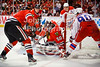 Chicago goalie Corey Crawford (50) makes a save on a stuff attempt by Washington center Marcus Johansson (90) during the NHL game between the Chicago Blackhawks and the Washington Capitals at the United Center in Chicago, IL. The Blackhawks defeated the Capitals 5-2.