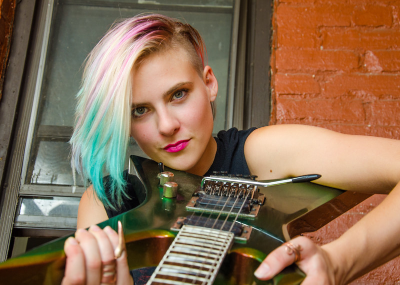 modeling headshot with guitar