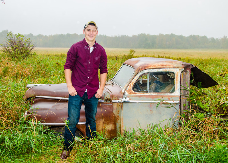 senior guy with old car photo