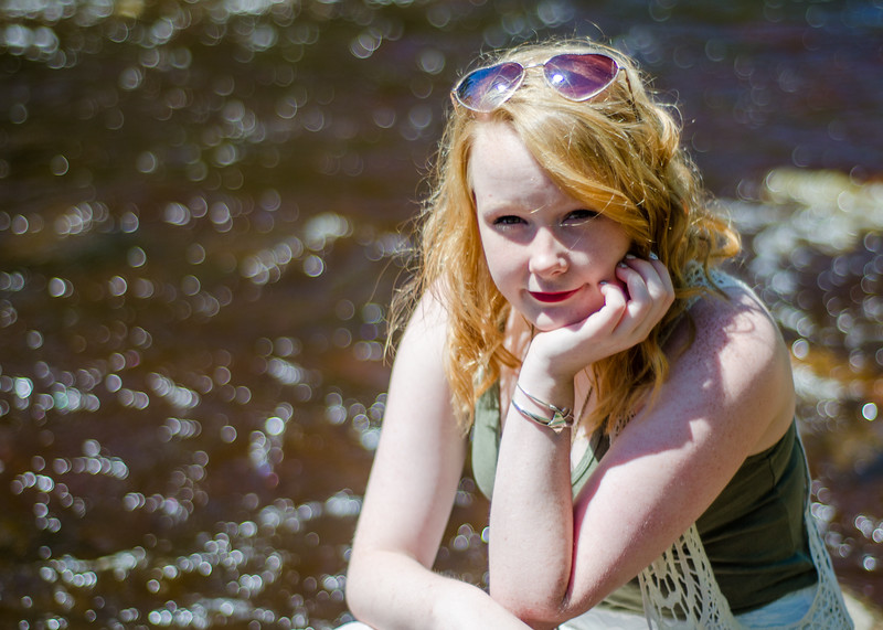 senior girl portrait down by the river