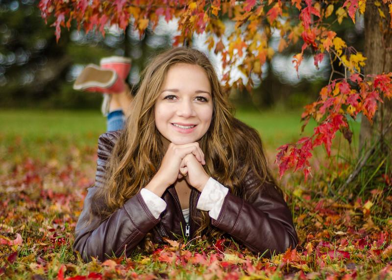 senior girl in fall leaves