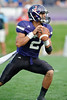 Northwestern quarterback Kain Colter (2) drops back to pass during the NCAA football game between the Northwestern Wildcats and the Eastern Illinois Panthers at Ryan Field in Evanston, IL.  Northwestern defeated Eastern Illinois 42-21.