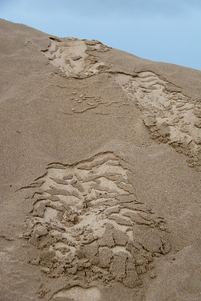 """<span id=""""title"""">Footprints</span> Since it had been raining, this is what my footprints look like when I walked down a small dune. I wasn't a fan of all the rain, but it allowed me to get this neat photo."""