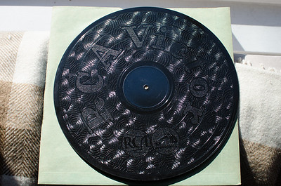 "The back, unrecorded side of a 12"" 78rpm record from the 1940's."