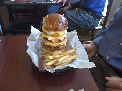 A quad burger from Sobleman's in Milwaukee, WI. They will stack a burger up to seven pattys high. Mike had this and most of his fries down by the time the rest of us finished our singles.
