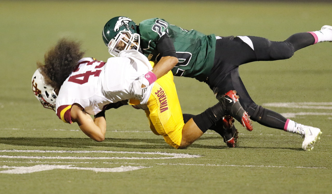 #20 Dominic Rodgers of Rodriguez HS tackles #43 Triston Schaumkel of Vintage HS. Friday. (Josh Redsun/Daily Republic)