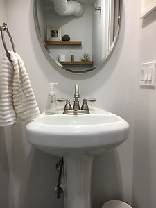 Misaligned Mirror over sink