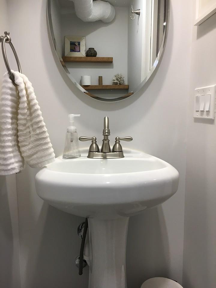 Misaligned Mirror over sink