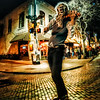 """<h2>The Wolfman Violinith</h2> <br/>Here's my favorite photo from the Austin Photowalk … one of the many street performers howls into the streetlight moon… <br/><br/>- Trey Ratcliff<br/><br/><a href=""""http://www.stuckincustoms.com/2013/03/19/the-great-austin-sxsw-photowalk/"""" rel=""""nofollow"""">Click here to read the rest of this post at the Stuck in Customs blog.</a>"""