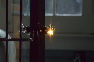 Sun refracts through doorknob