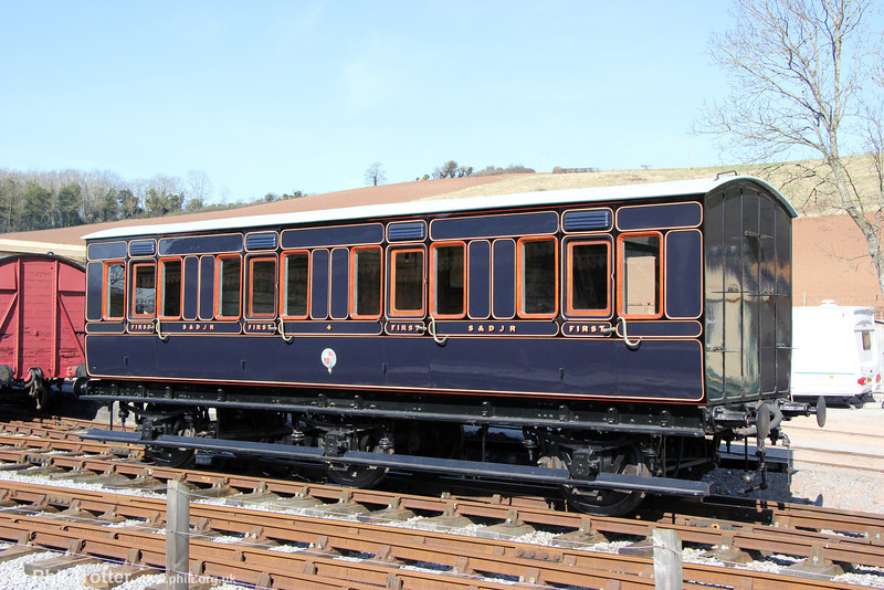 The Somerset & Dorset Railway Trust's newly restored S&D first class 4-compartment 6-wheel coach No 4 at Washford on 31st March 2013. The coach was built at Highbridge in 1886, taken out of use in 1930 and converted for use as a cricket pavilion at Templecombe. It was rescued by the Trust in 1986.