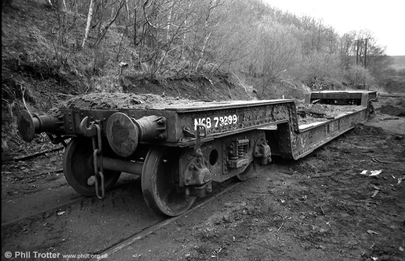 Former GWR 'Crocodile G' 35 ton bogie well wagon 41946 of 1909 seen at Wernos Coal Preparation Plant in April 1988, carrying the number NCB 79299. Note the former Great Western 'G' near the leading end of the well.