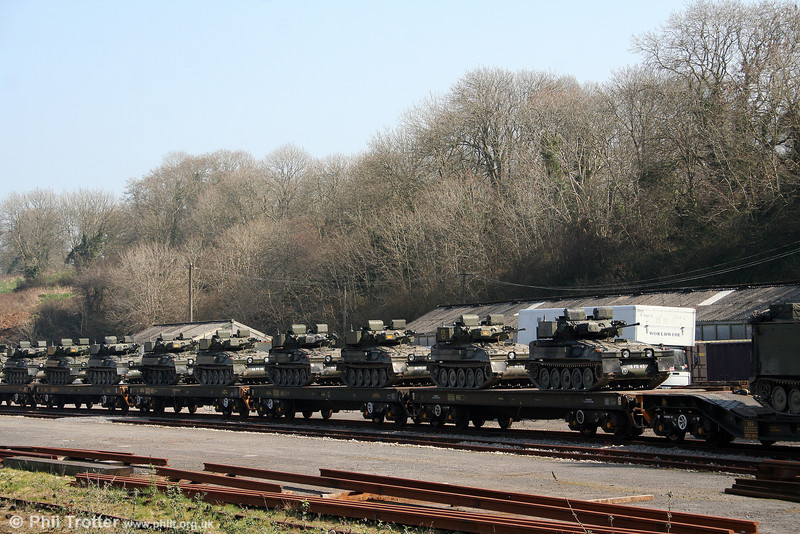 A train of 'Warflats' loaded with Armoured Fighting Vehicles at Haverfordwest on 20th March 2009. These were booked to departs as 6Z51, 1234 Haverfordwest to Doncaster Up Decoy.