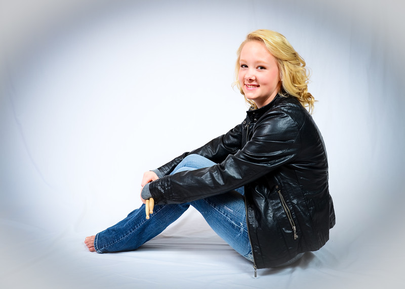 Senior Portrait of girl in leather coat with drumsticks