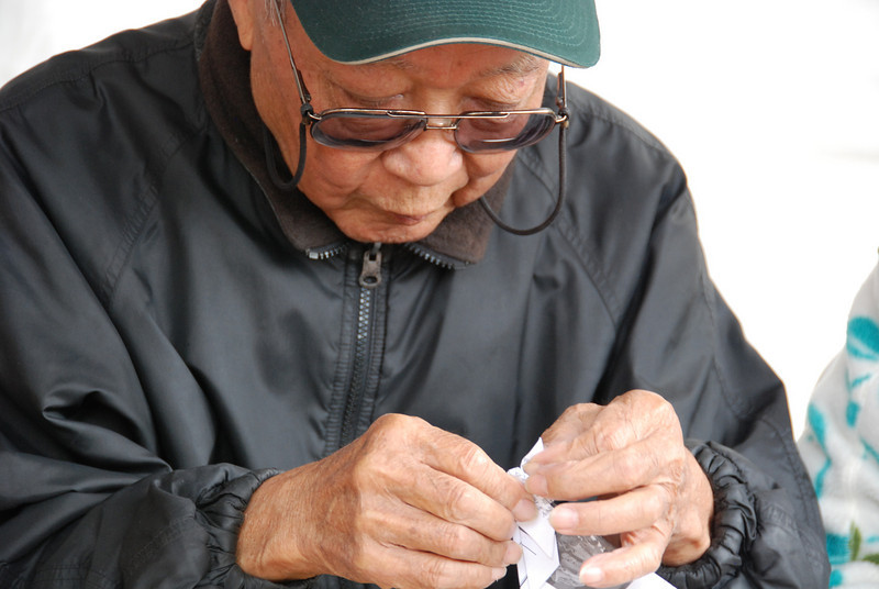 Old man making origami
