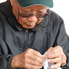 Old man making origami