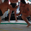 Sumo match - guy on right weighs over 400 lbs.
