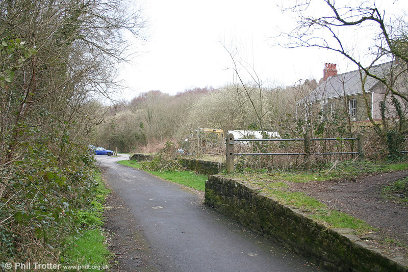 A view of Dunvant Station remains looking north towards Gowerton on 18th March 2007. The ramp (right, foreground) is a post-closure addiition which has narrowed the trackbed at this point. The line closed to passengers in 1964 and to freight the year after.