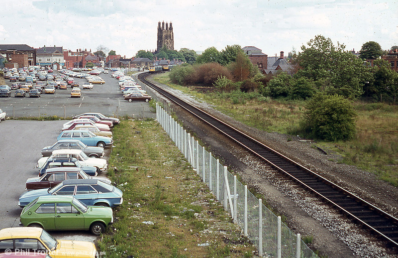 A view looking towards the former Wrexham Central Station taken during 1979. The station eventually closed on 23rd November 1998 and a new station constructed behind the photographer. This part of the line was lifted and the area in the photograph redeveloped as a shopping centre.