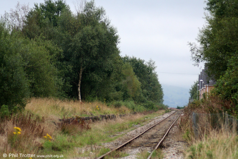 The remains of Hirwaun Station, looking east on the Vale of Neath Line, photographed on 31st August 2009. The station closed in 1962.