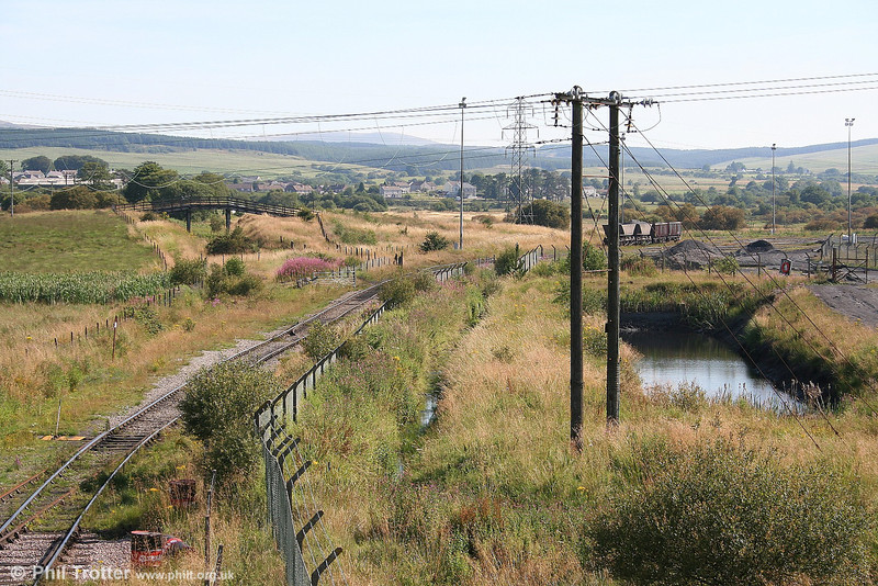 More 'Neath & Breconry'. This is the scene at Onllwyn on 25th July 2006. Looking North, the washery is to the right and formation of the former line towards Colbren Junction can be seen beneath the footbridge to the left.