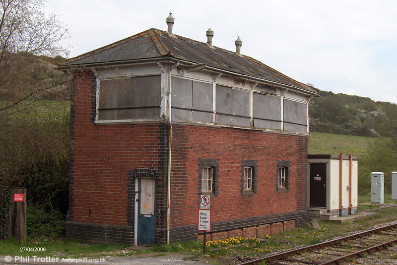 The boarded up GWR-style Signal Box at Maiden Newton, between Yeovil and Dorchester. Maiden Newton was the junction for the former Bridport Branch which closed on 5 May 1975. (Courtesy Justin Davies).
