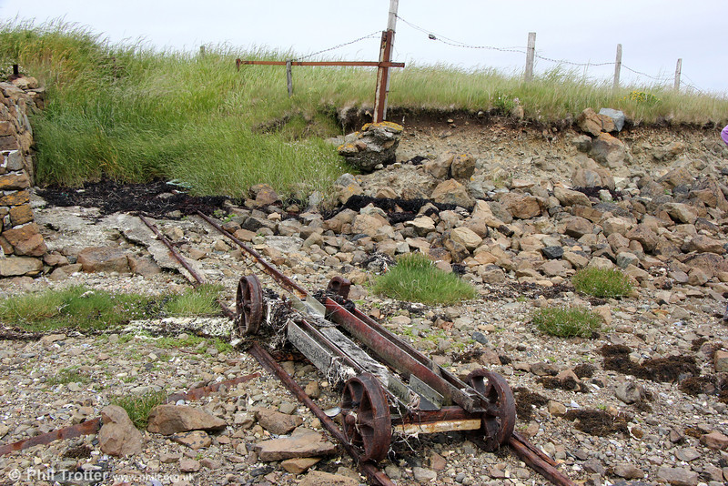 The most northerly rail 'vehicle' in the UK is this relic at Baltasound, on the Island of Unst, Shetland. The short track with its winch system was  used to transfer peat and other provisions to land after it had been brought in by boat. There was once an active herring processing station at Baltasound, so it is likely that the trolley was also used in that connection. 10th July 2013.