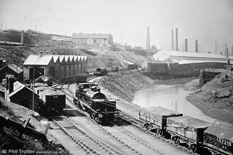 An historic view of the Vivian & Sons Ltd. locomotive shed at Hafod, Swansea including Beyer Peacock (6172/1924) 0-4-0+0-4-0 Garratt locomotive no. 10, and also illustrating some of the industry which once prevailed in this area.