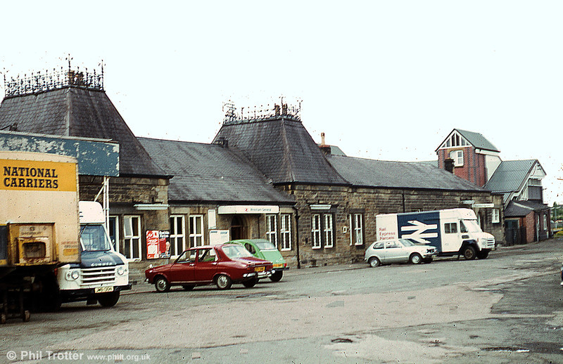 A view of the approach to Wrexham General Station in 1979. The station has recently been restored, but BR's Commer Walk-Thru vans and its C&D parcels service are history.