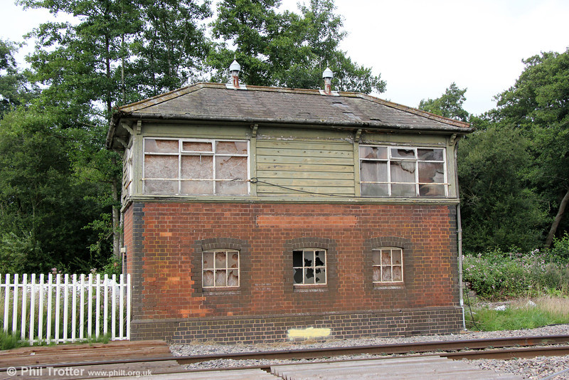 Disused since 1973 when local signalling was centralised at Gloucester, Awre Signal Box still remains. It was located close to the junction for the erstwhile Forest of Dean Central Railway which served industries in the forest. The box was built in 1909 and photographed on 26th August 2013.