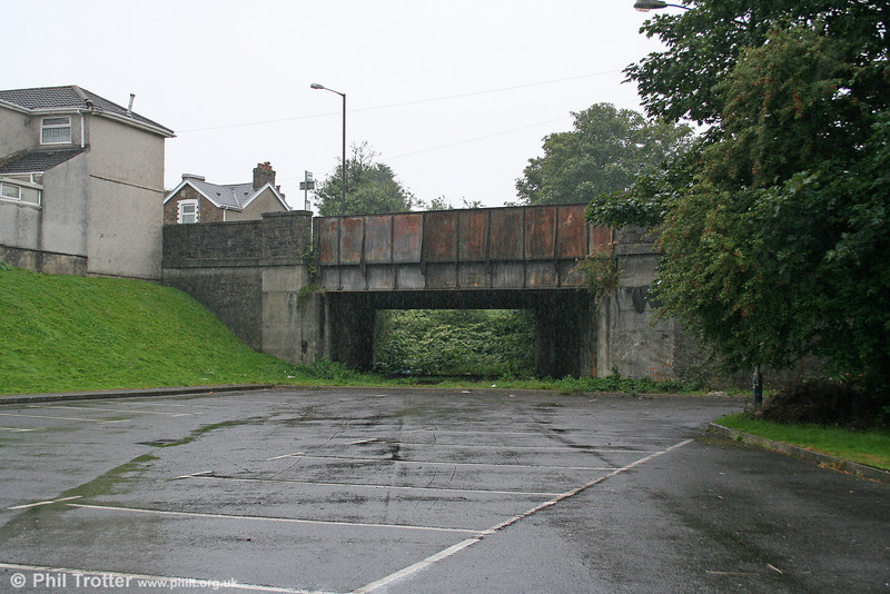 A picture taken from the site of the GWR's Morriston Station looking north on 23rd August 2009. BR renamed it Morriston (West) to distinguish it from the Midland Railway station, Morriston (East). The line continued beyond the A48 overbridge to meet the Swansea District Line at Felin Fran and on occasions was used as a diversionary route when engineering work prevented trains reaching Swansea High Street via Llansamlet.