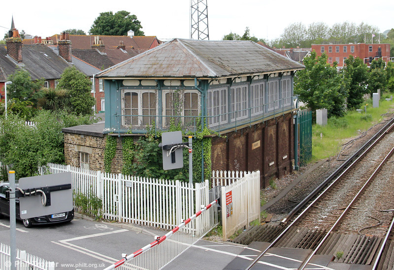 Havant Signalbox, 23rd June 2012. The original part of the signal box was built when the line was originally opened in 1847. It is attributed to be a Saxby and Farmer design. The signalman operated the old style gates with a wheel at the end of the box.<br /> Up until 1963, the Hayling Island branch ran behind the box and up until 1977 there was also a goods yard, now housing.<br /> In 1938, a rebuild took place of the station, and the signal box was extended as it is now seen. The windows at the bottom were bricked up at the start of the war. The grade II listed building has been disused since resignalling took place in 2007.