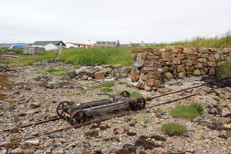 A second view of the long disused trackway with its wagon at Baltasound, Shetland. 10th July 2013.