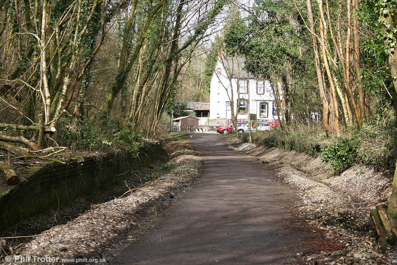 Another view of Killay Station looking north. The former station building (white) is now a celebrated real ale hostelry, named appropriately 'The Railway Inn'. Efforts to improve drainage have revealed vast quantities of ballast!