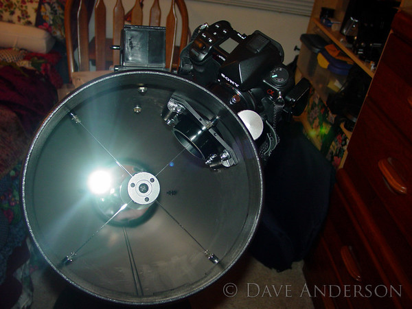 Orion XT8 Telescope modified with custom-mount low-profile focuser to enable use with DSLR. Effective 1200mm f/5.9 rigged as shown.