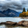 "<h2>The Remarkable Mood</h2> <br/>Oh wow do I love New Zealand!  Every city I have been to is remarkable in its own way, and I was particularly struck by the environs around Queenstown.  It's just an amazing place.  I've been completely swamped with photo activities, but I stayed up till 4 AM in my ""HomeCar"" (as my daughter calls it) to process this photo.  It's all a perfectly magical place, as you can plainly see here.  This was the beginning of a three-hour sunset drive that went around this same lake...  every stop was more moody than the next.<br/><br/>That mountain range?  It's called ""The Remarkables"".  What a cool name. <br/><br/>- Trey Ratcliff<br/><br/><a href=""http://www.stuckincustoms.com/2010/03/03/the-remarkable-mood/"" rel=""nofollow"">Click here to read the rest of this post at the Stuck in Customs blog.</a>"