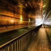 """<h2>Tokyo Tunnel</h2> <br/>During a fun photowalk in Tokyo, we were doing our best to get a city shot around sunset.  We speculated that perhaps the best way to get from Point A to a mysterious Point B was to go through this tunnel.  It didn't quite get us where we wanted to go, but we did arrive someplace <em>different</em>. <br/><br/> - Trey Ratcliff <br/><br/>The full post is available <a href=""""http://www.stuckincustoms.com/2010/07/09/tokyo-tunnel-creative-commons-under-attack/"""">here.</a>"""