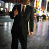 """<h2>Shopping in the Rain</h2> <br/>This businessman was strolling down the street, doing some light window shopping.  The 50mm 1.4 prime did most of the work here for me, even though it did require manual focus.  That bit was hard.  Real hard ... <br/><br/> - Trey Ratcliff <br/><br/>Some exciting news about a new print and the rest of this entry is <a href=""""http://www.stuckincustoms.com/2010/07/11/shopping-in-the-rain-portofino-print-available/"""">here.</a>"""