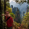 """<h2>Climbing the Spires of Pandora</h2> <br/>Here's a photo of me on another one of my masochistic (but awesome!) photo adventures around the world. See all those spires back behind me? I'm actually up on top of one of them. This is a hard-to-reach area of southern China that was the inspiration to some of those scenes from Avatar. I climbed those spires twice in the same day. I got to one of the top of them just as the sun set, and had to descend in the middle of the absolute dark. I had a tiny flashlight on my camera that kept me out of trouble. I'll never forget the time I was two inches from stepping on this very mysterious and bad-ass snake that would have liked nothing better than to rock my face off. And yes, when I travel, I miss my family. They often meet me for bits and pieces.<br/><br/>- Trey Ratcliff<br/><br/><a href=""""http://www.stuckincustoms.com/2011/09/28/the-rest-of-the-chinese-snake-story/"""" rel=""""nofollow"""">Click here to read about this place at the Stuck in Customs blog.</a>"""