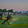 "<h2>The Golden Knights are Bad Ass</h2> <br/>I have not had much time this weekend to process new photos, but I did take a moment to process this one. <br/><br/>This was taken during an evening demonstration on the night before OpenCamp began.  It was an unforgettable night with the Knights!  After falling a few miles from the sky, the skydivers would open up their chutes & pyrotechnics and let loose.  Since I had jumped with them the day before, they let me get up close on the landing to get some tight shots.<br/><br/>- Trey Ratcliff<br/><br/><a href=""http://www.stuckincustoms.com/2010/08/29/golden-knights/"" rel=""nofollow"">Click here to read the rest of this post at the Stuck in Customs blog.</a>"