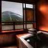 "<h2>The Peaceful Ryokan Baths of Hakone</h2> <br/>Whilst on my last trip to Japan, I did feel like a samurai photographer, traveling the countryside hard by day, and sleeping in ryokan by night.<br/><br/>A ryokan is a traditional Japanese inn, and they feature everything one might expect from the visions that are coming in and out of your head.  There is a tatami floor, with a mat or futon upon it.  The rooms are separated by classical sliding doors of rice paper.  There are also communal or private hot baths for relaxation.  In the one below, I had a private bath that overlooked the countryside near Hakone.  This room also came with a traditional Japanese dinner served by women in full and traditional Japanese outfits.<br/><br/>After dinner, and by the time I got myself out of that tub, I think I was more physically drained than I had ever been in my life... it was just wonderful... and I look forward to more ryokans on this next trip!<br/><br/>- Trey Ratcliff<br/><br/><a href=""http://www.stuckincustoms.com/2010/03/12/workshop-in-tokyo-london-announced/"" rel=""nofollow"">Click here to read the rest of this post at the Stuck in Customs blog.</a>"