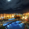 "<h2>Night View from Balcony in Ibiza</h2> <br/>Ibiza is a really strange place.  This hotel (Ibiza Gran) seemed to be typical of hotels in Ibiza when it came to the clientele.  Here's the deal...  if you have never heard this, you'll think it sounds pretty strange -- and it is. <br/><br/>So a lot of people in Ibiza dress in all white.  White pants, white shirt, free-flowing fabrics, and cavalier attitudes flow in and out of the hotel lobby, bar, poolside restaurant, and the spa.  It's all very strange.  It's sort of a combination of a Clockwork Orange and a Euro Sci-Fi Orgy.  I can't quite explain it...  I'm not sure I understand it, and I didn't succumb, even though everyone did seem very comfy. <br/><br/>After a long day of exploring and shooting, I went out on the balcony to get a shot of the pool and the moon behind the clouds. <br/><br/> - Trey Ratcliff <br/><br/>Read more <a href=""http://www.stuckincustoms.com/2011/05/02/night-view-from-balcony-in-ibiza/"">here</a> at the Stuck in Customs blog."