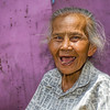 "<h2>This is Sujatmi</h2> <br/>Sujatmi's dream is that her grandkids grow up to be brave and smart. <br/><br/>She is currently sitting in a makeshift annex area in a bustling riverside community in Jogjakarta, Indonesia. Dozens of tiny thatched and improvised houses are cobbled together and brightly painted. There are kids running around and other adults running after them, trying to get them to sit still so they can begin school. I've accidentally interrupted the whole affair while getting confused in the tiny alleys, no wider than a set of shoulders. She's thrilled by the excitement as she looks on, nodding at me and the kids. <br/><br/>- Trey Ratcliff<br/><br/><a href=""http://www.stuckincustoms.com/2008/08/02/this-is-sujatmi/"" rel=""nofollow"">Click here to read the rest of this post at the Stuck in Customs blog.</a>"